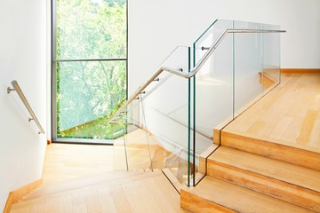 Foto op Plexiglas Trappen Modern architecture interior with wooden stairs