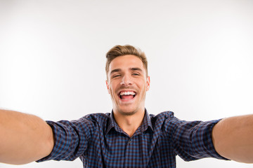 Handsome man making selfie and smiling