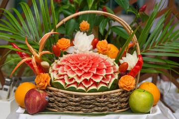Thai fruit carving in wicker basket