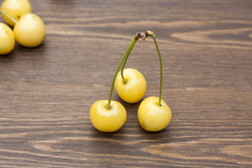 Fresh yellow cherryon a wooden background, selective focus
