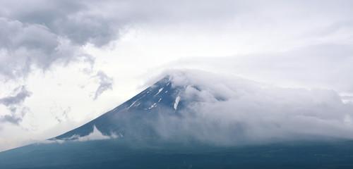 Fuji in stormy clouds
