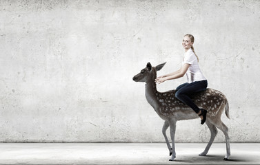 Fototapete - Woman ride deer