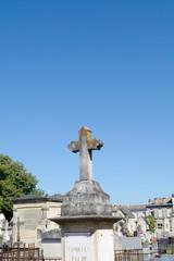 Graveyard cross in cemetery
