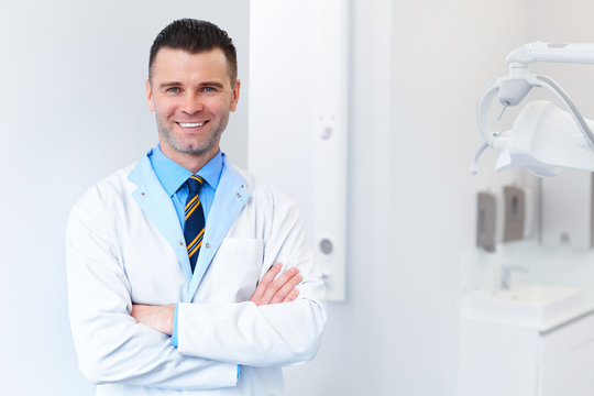 Dentist Doctor Portrait. Young Man at His Workplace. Dental Clinic