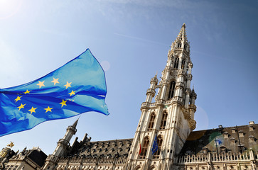 Foto op Canvas Brussel The townhall of Brussels and a flag of European Union