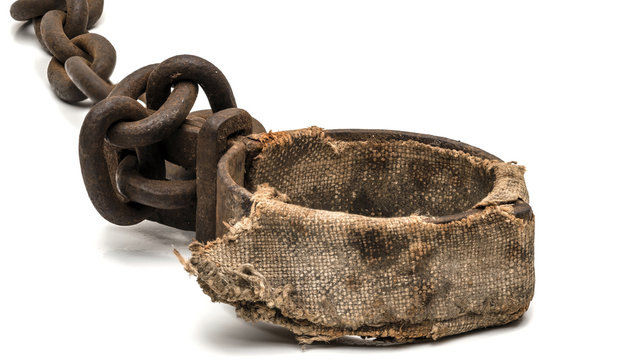 Rusty padded shackles used for locking up prisoners or slaves between 1600 and 1800.  This might be a leg cuff or a neck cuff