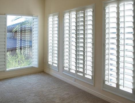 White style wood Shutters for luxury Interior Design in condo.