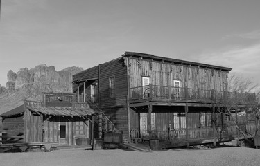 Old Wild West Cowboy town mountains in background in black and white