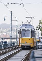 Yellow tram ride along the rails