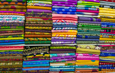 Pile of cloth fabrics at a local market in Bangladesh.