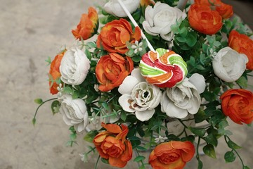Candy and roses of artificial flowers
