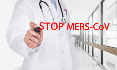 Doctor writing Stop Mers-Cov text on transparent board