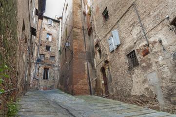 Fototapete - Medieval Street in Siena, Tuscany, Italy