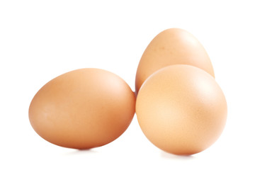 Organic Brown Chicken Eggs Isolated on White Background.