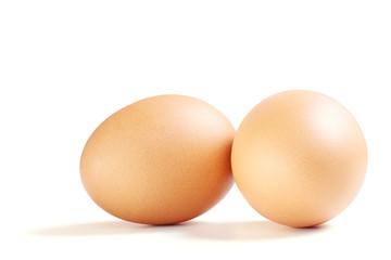 Organic Brown Chicken Eggs on White Background.