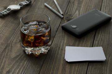 whiskey, phone, clock