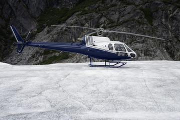 Single-engine helicopter landed on an Mendenhall Glacier, Alaska