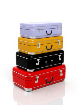 Stack of four colorful travel suitcases isolated on white