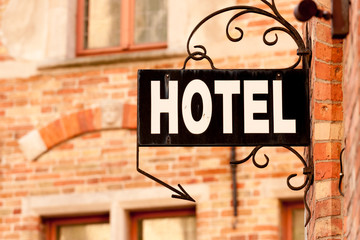 Hotel sign at the entrance of cozy accommodation in European city