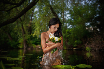 beautiful young woman relaxed in water