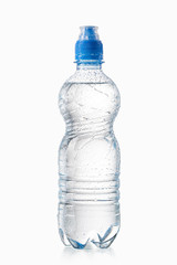 Water. Small plastic water bottle with water drops on white back