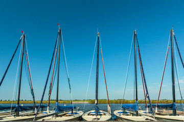 Row of small Dutch sailing boats used for lessons