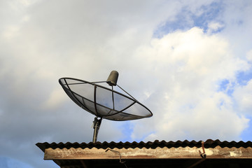 Satellite dish with blue sky and cloud background
