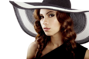 Beautiful brunette in the hat isolated on white
