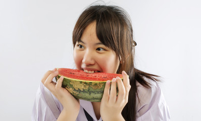 Asian girl enjoing a water-melon