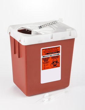 Medium size sharps container used for medical and dental waste.