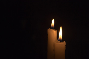 Two White Candles Burning at Night Time