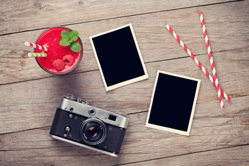 Camera, photo frames and raspberry smoothie