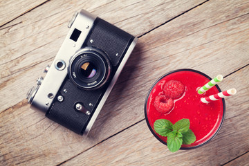 Vintage camera and raspberry smoothie