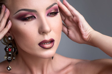 Beautiful girl with evening  burgundy makeup