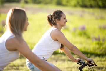 Pretty teen girls cycling