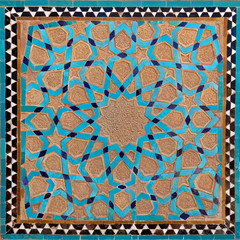 Traditional Old Islamic Design made of Brown Clay and Blue Tiles in Yazd