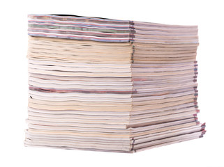 Stack of old magazines isolated