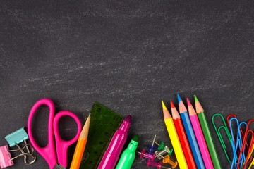 School Supplies Bottom Border On A Chalkboard Background