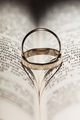 Ring, book, church.