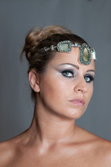 Blonde beautiful girl with smokey eyes makeup and a crown of jew