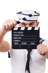 Sailor with movie board isolated on white