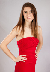 Pretty woman in red dress, smiling