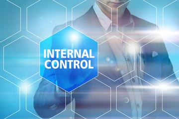 Businessman pressing internal control button on virtual screens.