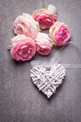 Fresh  pink roses and decorative white heart