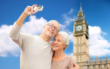 senior couple taking selfie on camera over big ben