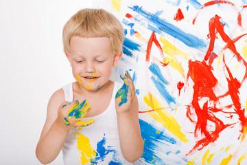 Portrait of a little messy kid painter. School. Preschool. Education. Creativity