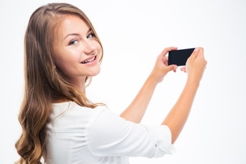 Woman making photo on smarptone