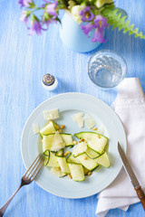 Partly Eaten Appetizer: Raw Zucchini Carpaccio with Roasted Pine Nuts and Parmesan Shavings