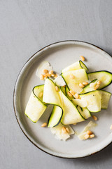 Raw Zucchini Carpaccio with Roasted Pine Nuts and Parmesan Shavings