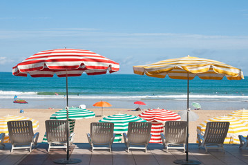 Striped umbrellas on the beach Biarritz, France